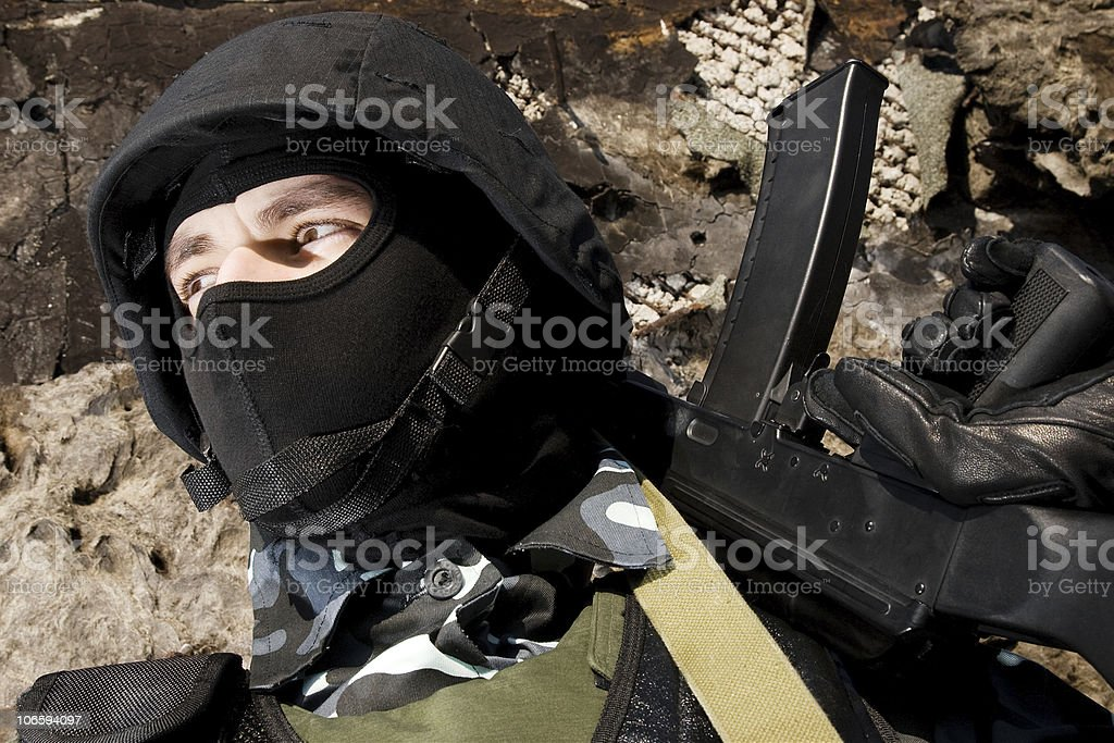 Soldier with a rifle on guard royalty-free stock photo