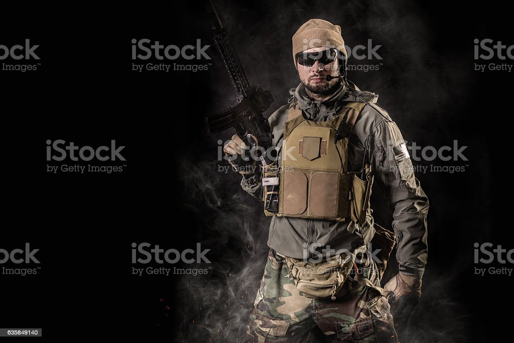 soldier with an assault rifle stock photo