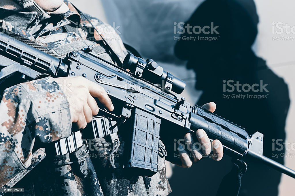 Soldier with assault rifle, officer give orders stock photo