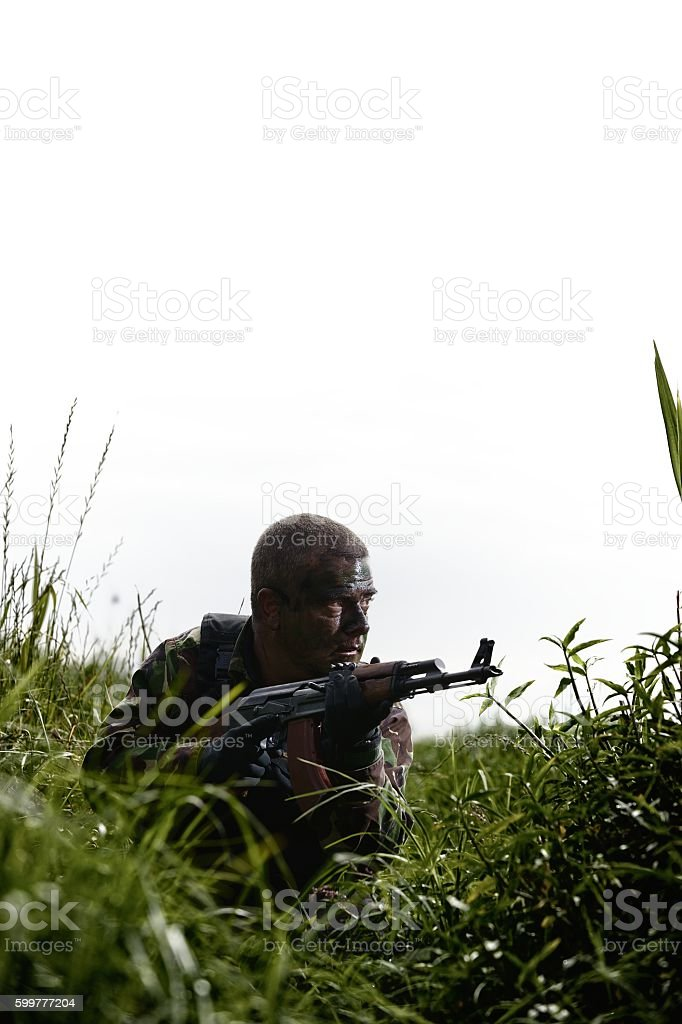 Soldier with assault rifle on recce mission stock photo