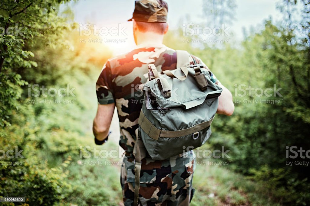 Soldier with backpack stock photo
