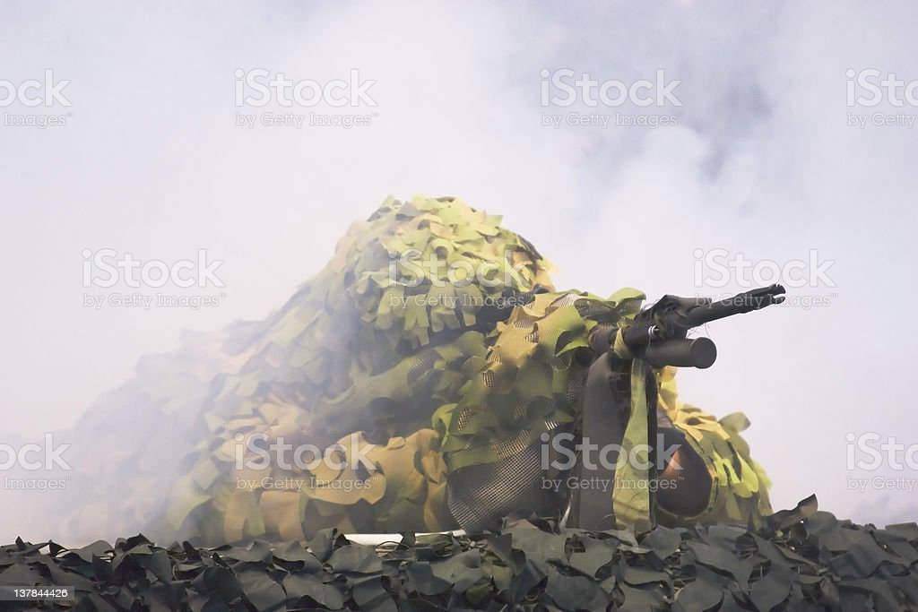 soldier with camouflage and machine gun stock photo