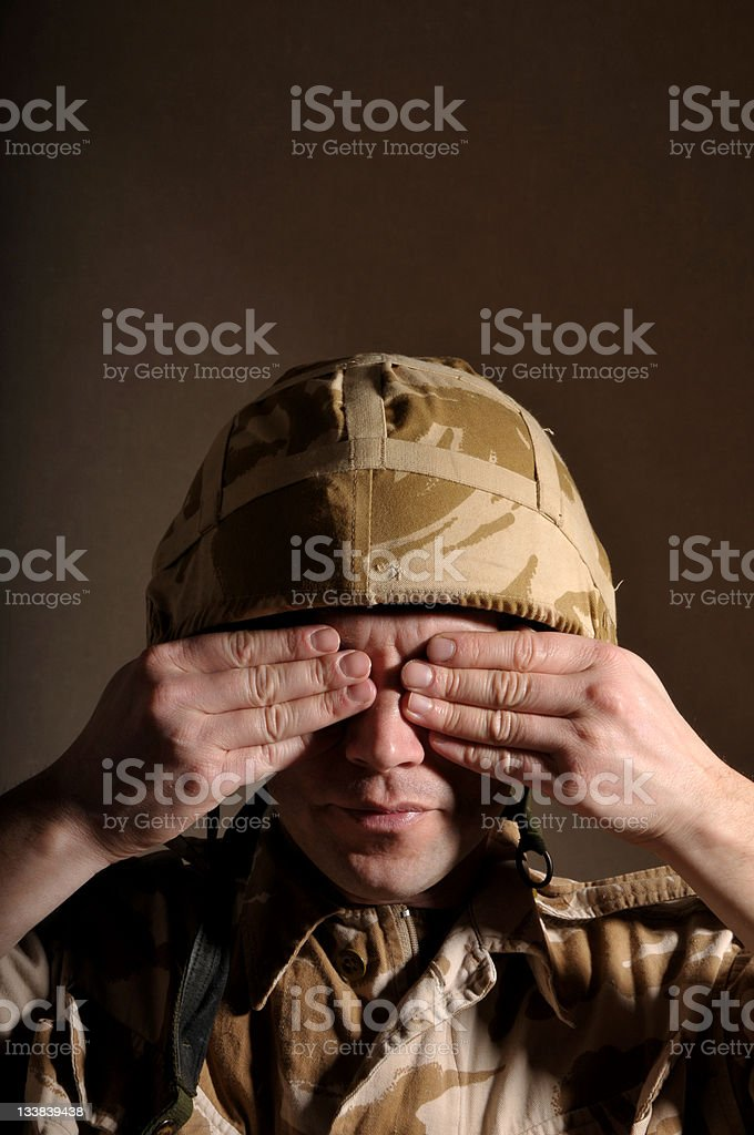 Soldier with eyes covered royalty-free stock photo