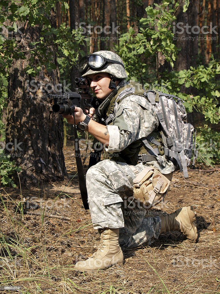 Soldier with M4 Carbine aiming royalty-free stock photo
