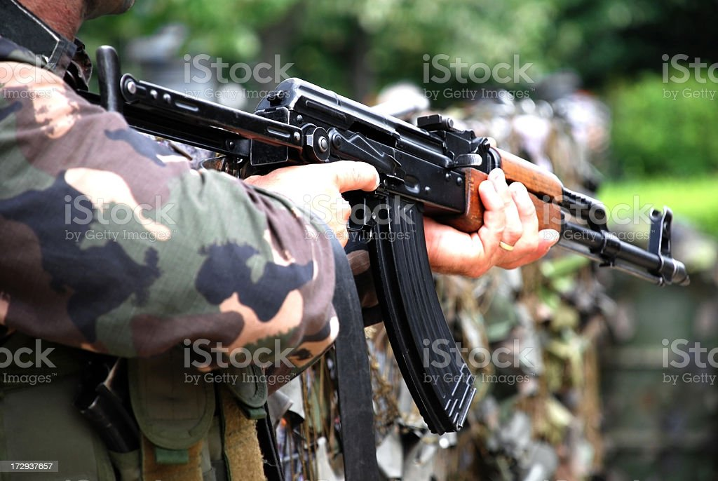 soldier with machine gun in hands royalty-free stock photo