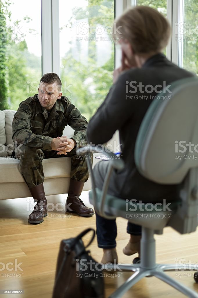 Soldier with physical trauma stock photo