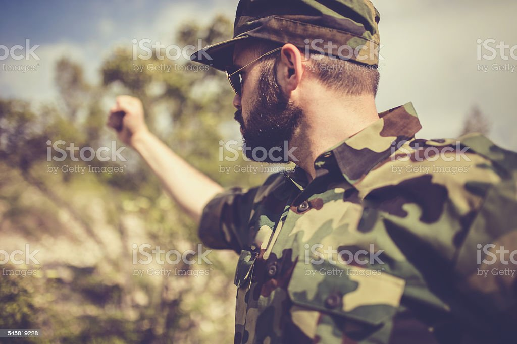 Soldier with raised fist stock photo