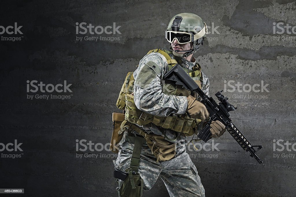 Soldier with rifle and mask stock photo