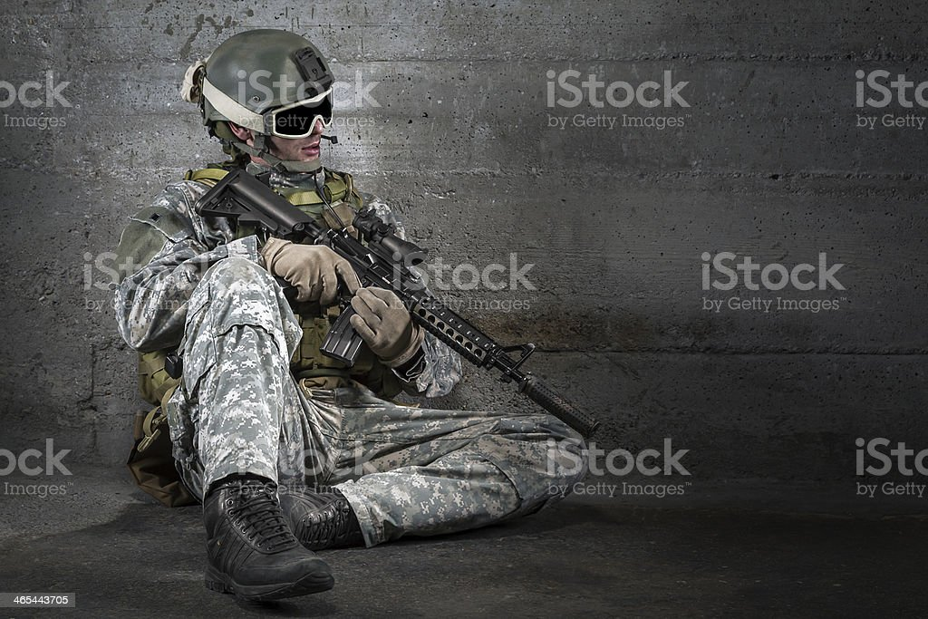 Soldier with rifle and mask resting stock photo