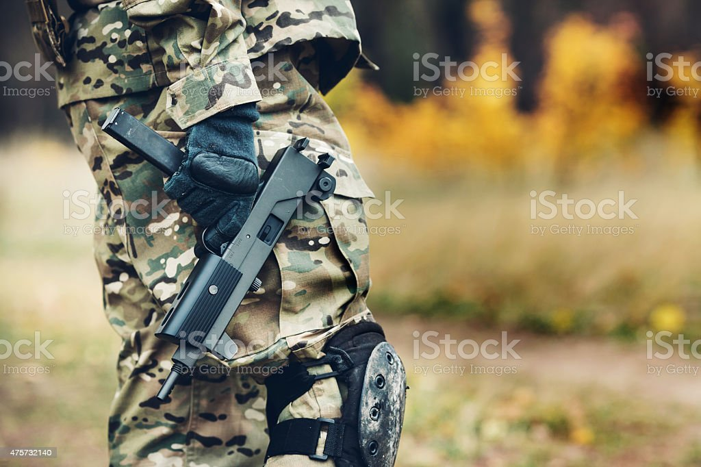 soldier with rifle in the forest stock photo