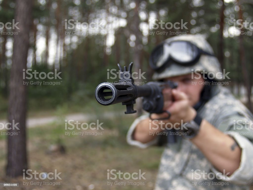 Soldier with rifle stock photo