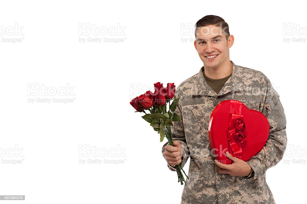 Soldier with roses and gift stock photo