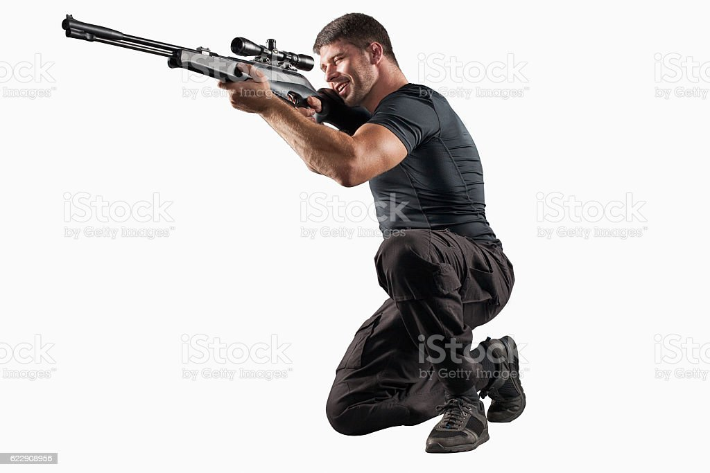 Soldier with sniper rifle aiming isolated on white stock photo