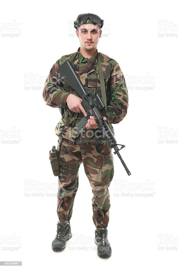 Soldier with weapon, isolated on white royalty-free stock photo