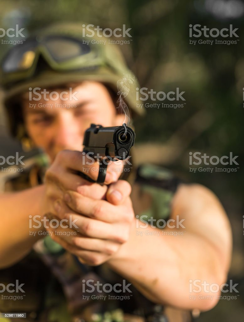 soldier with weapon stock photo