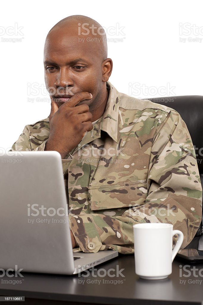Soldier working on a laptop royalty-free stock photo