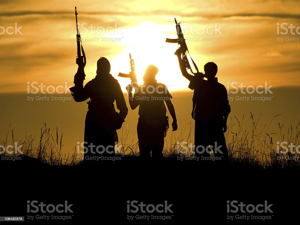 soldiers against a sunset stock photo
