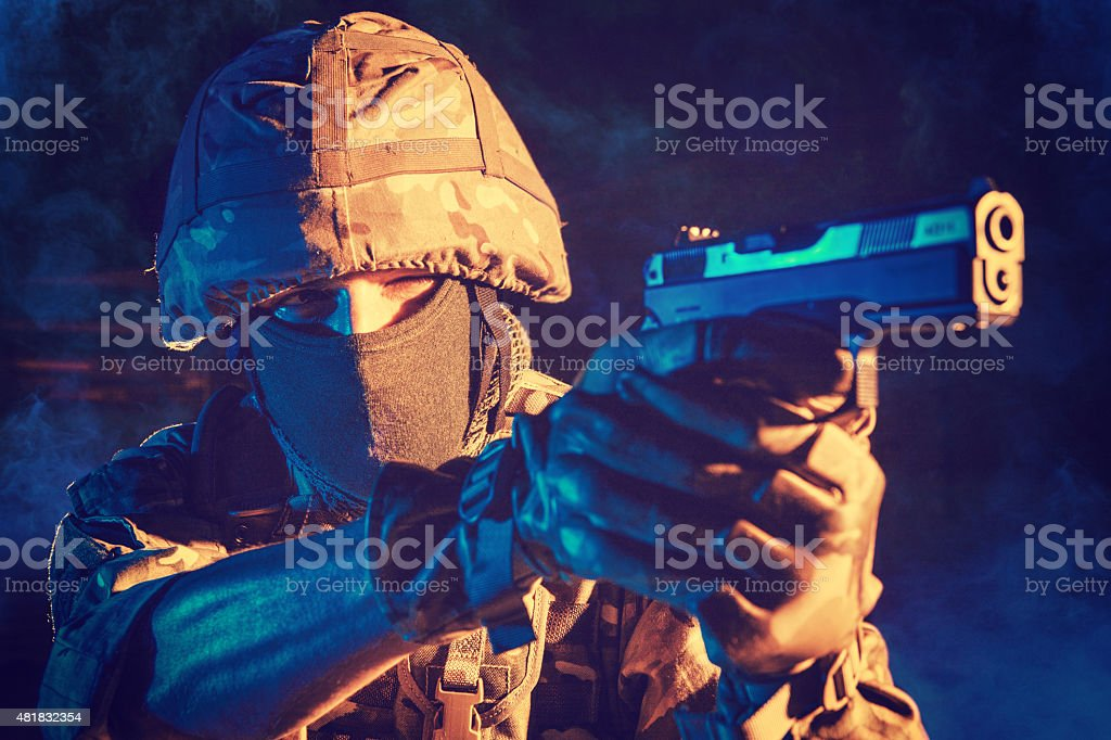 soldiers aiming with his pistol. stock photo