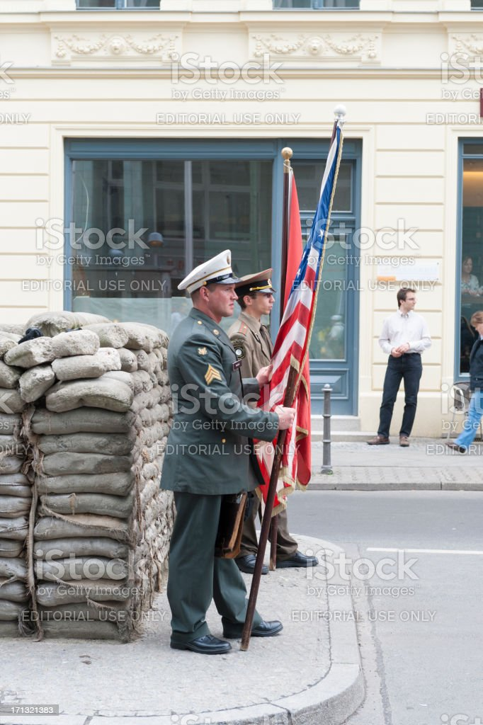 Soldiers at guard, Checkpoint Charlie in Berlin royalty-free stock photo