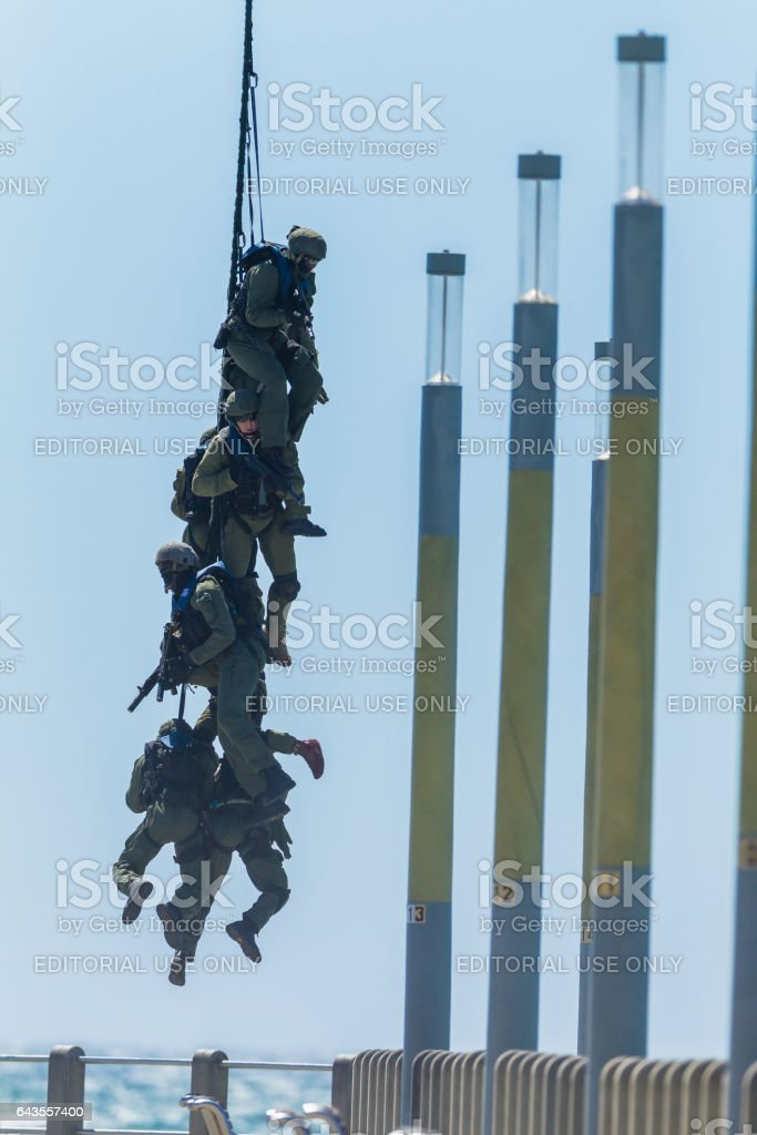 Soldiers Attached Rope Flying Helicopter stock photo