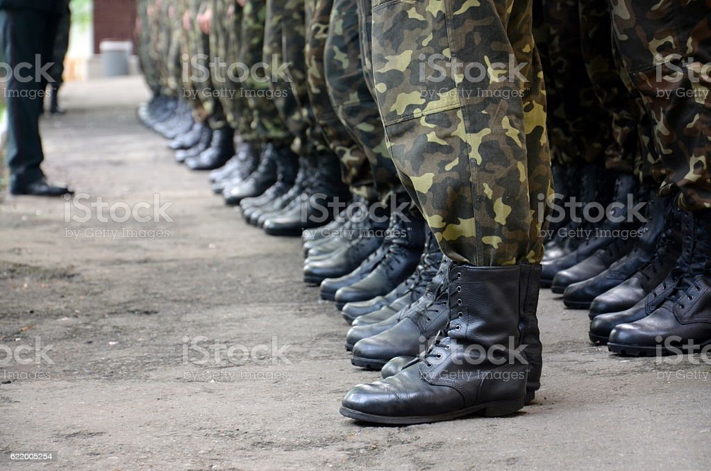 soldiers boots in army stock photo