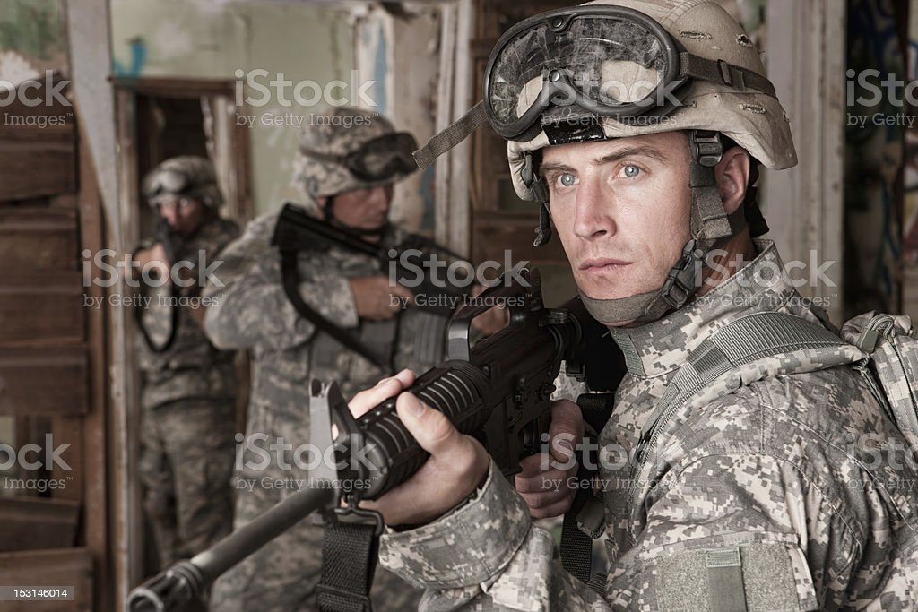 Soldiers Clearing an Abandoned Building stock photo