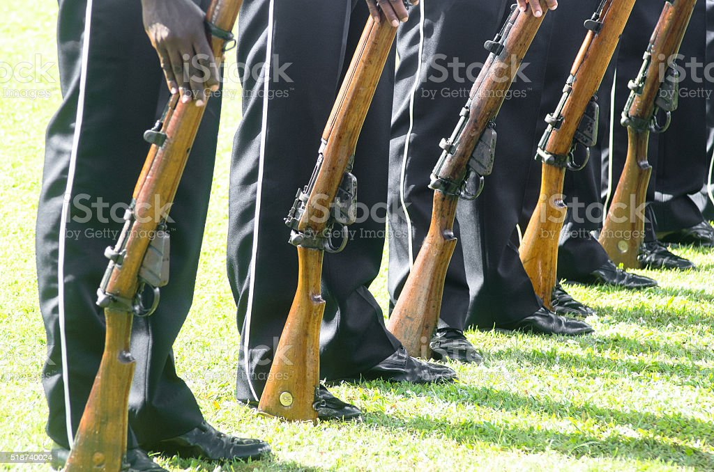 soldiers drilling with rifles in line stock photo