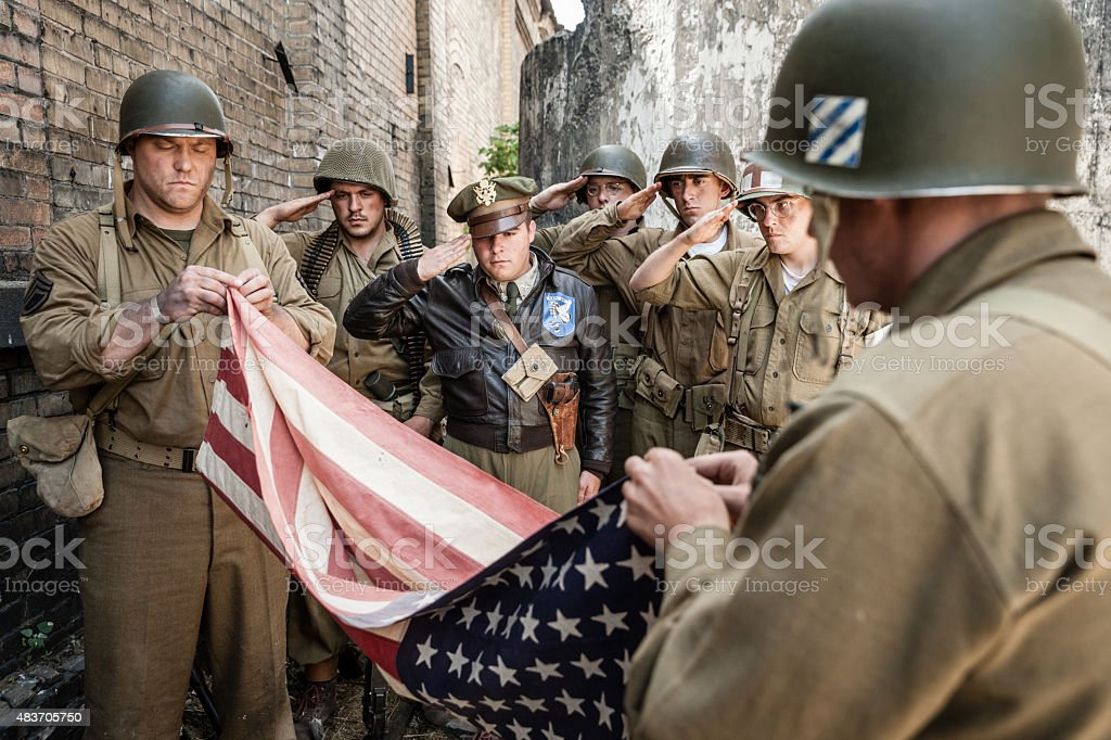 WWII Soldiers Folding Flag Ceremony stock photo