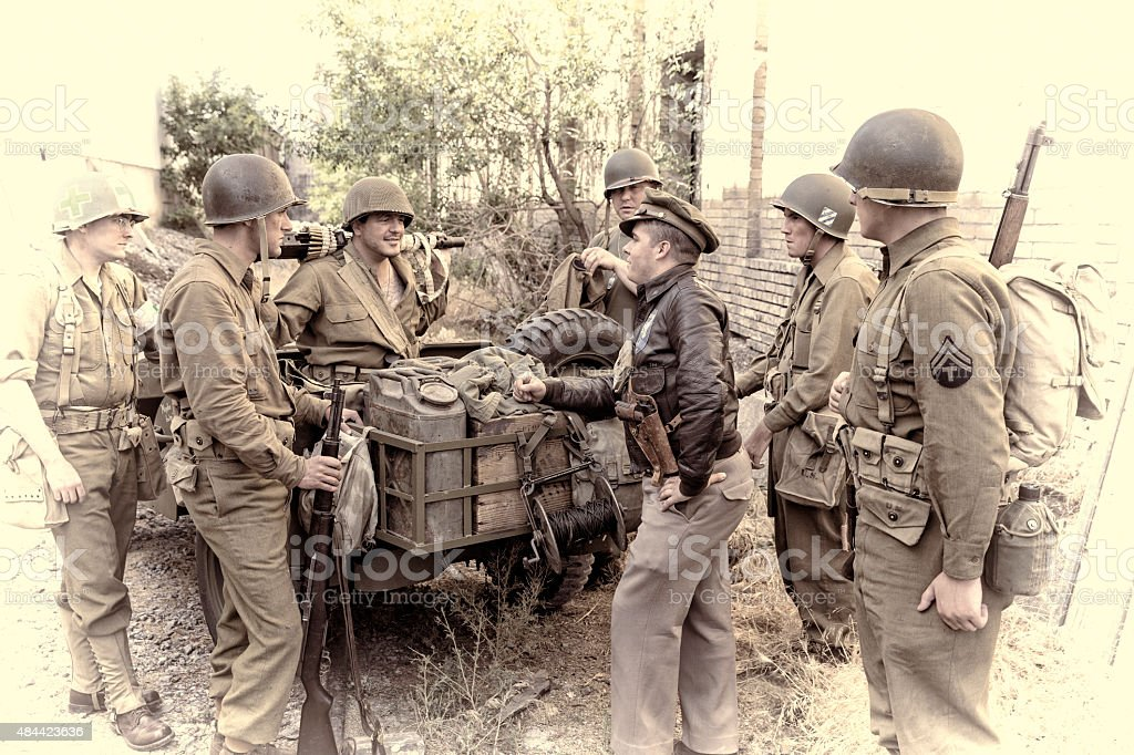 WWII Soldiers Get Ready to Go Out on Patrol stock photo