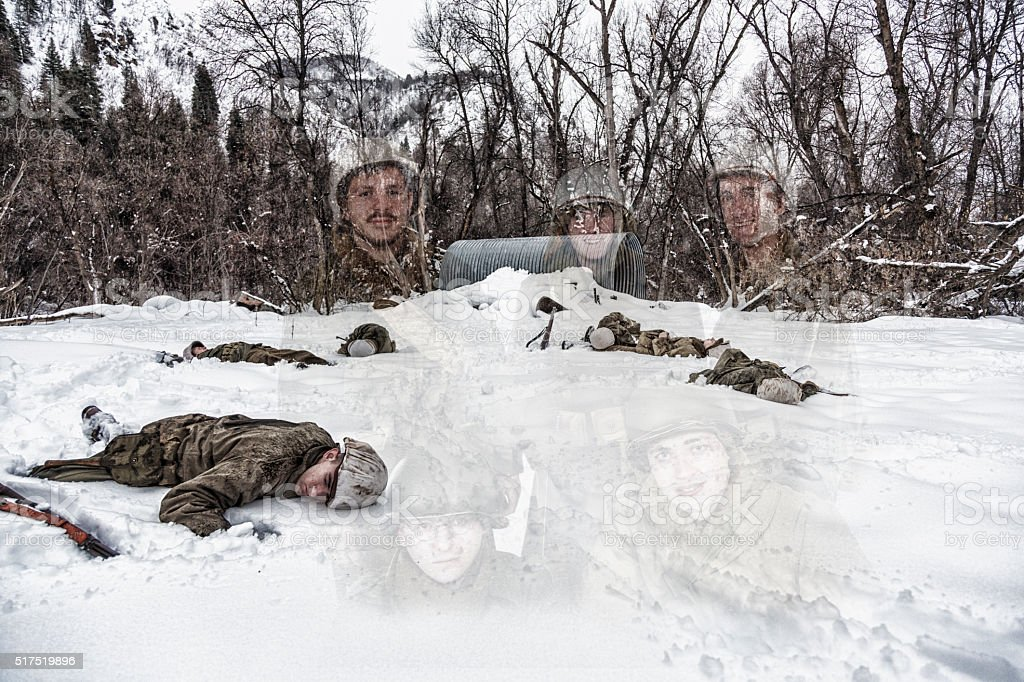 WWII Soldiers Group Portrait Superimposed on Dead War Casualties stock photo