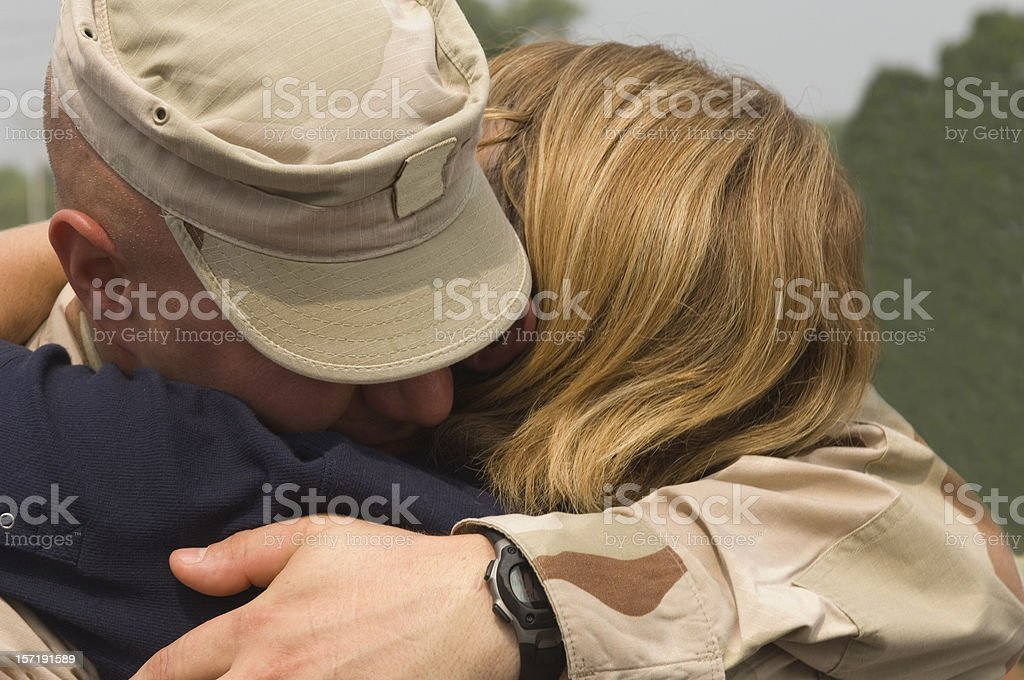 Soldiers Hug Uniformed Military Male Hugging Female Close Up royalty-free stock photo