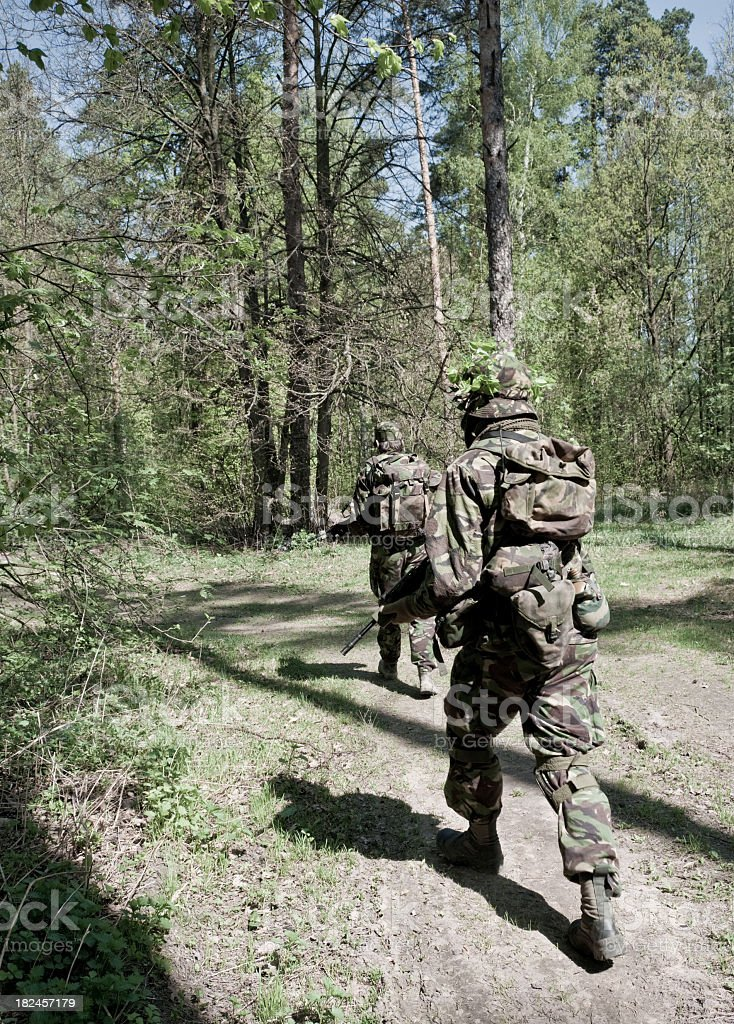 soldiers in a forest royalty-free stock photo
