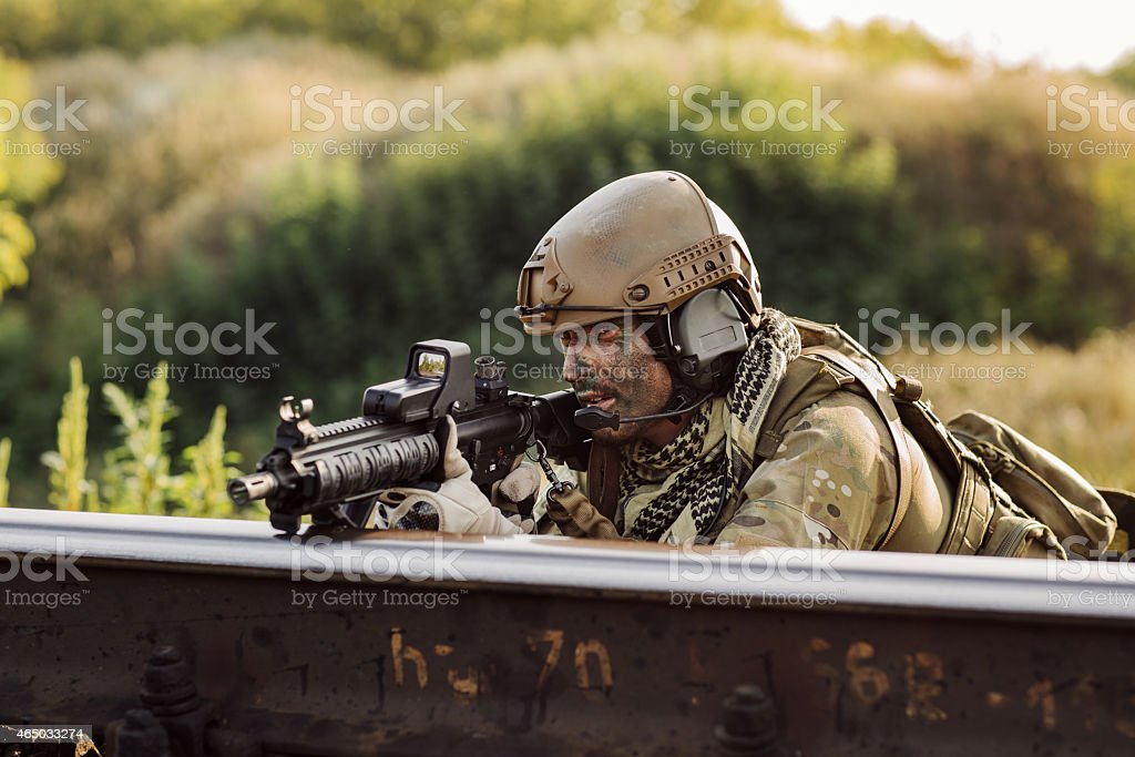 soldiers in an ambush aiming at the enemy stock photo