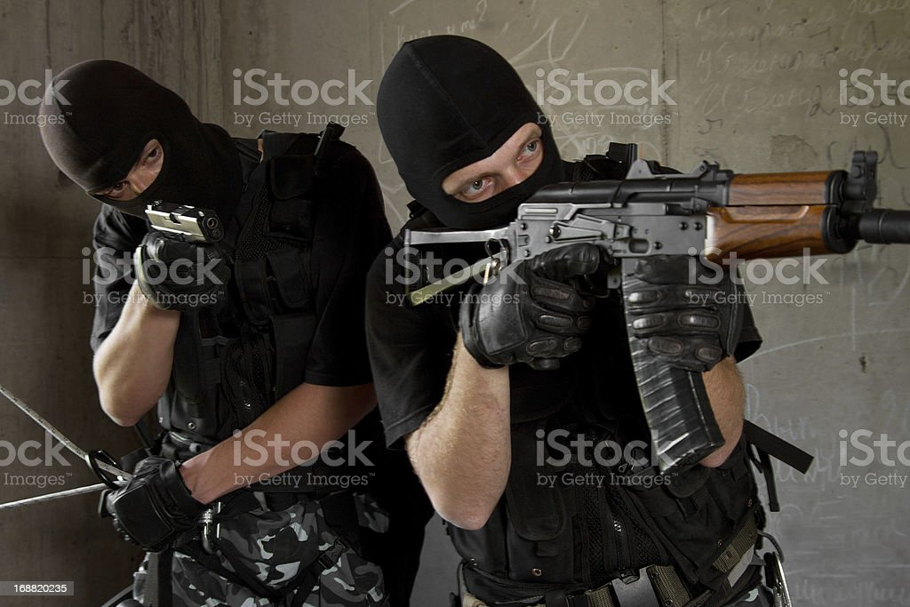 Soldiers in black masks with weapons royalty-free stock photo