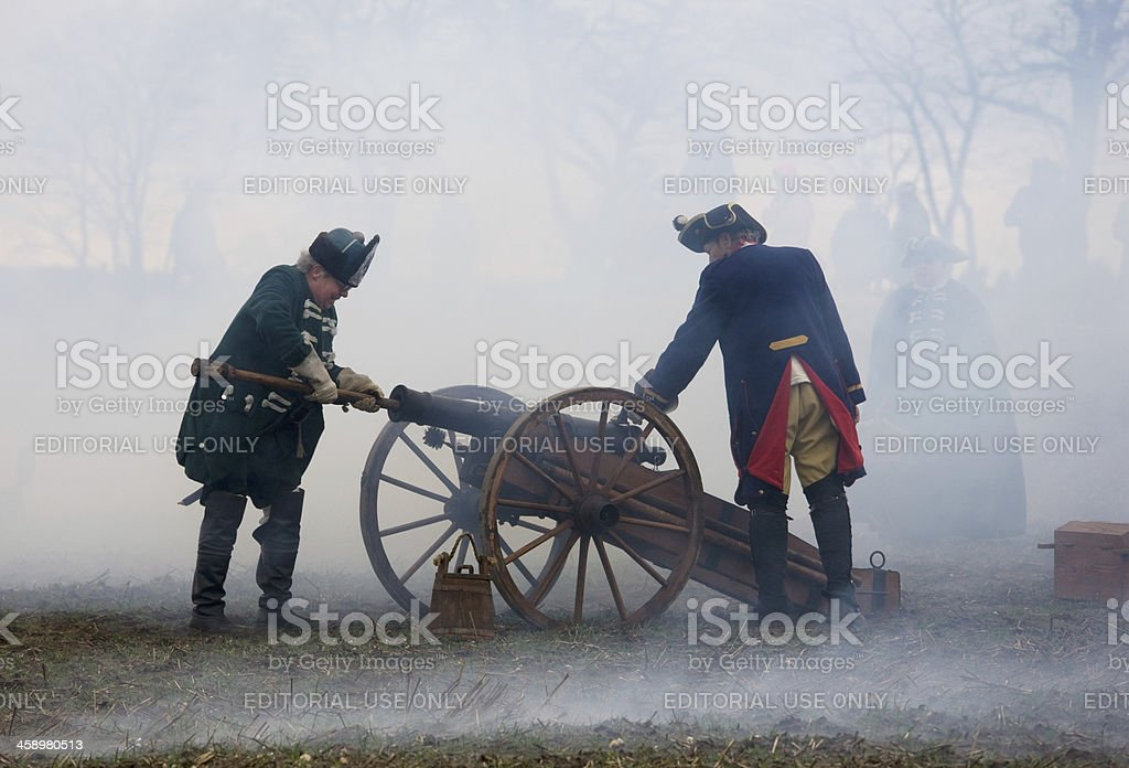 soldiers in historic regimentals with medieval cannon royalty-free stock photo