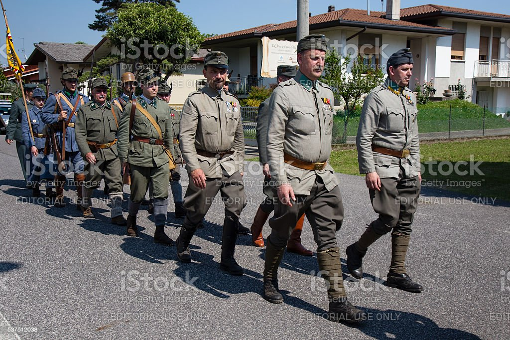 Soldiers in military uniforms on Foot -  War Reenactment stock photo