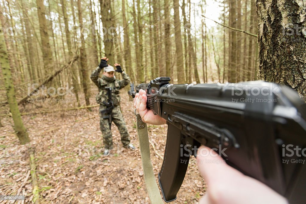 soldiers in the coniferous forest with a gun stock photo
