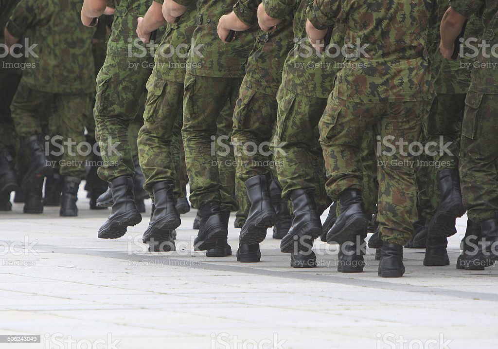 Soldiers march in formation royalty-free stock photo