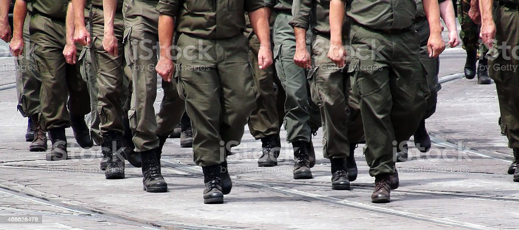 Soldiers marching in formation stock photo
