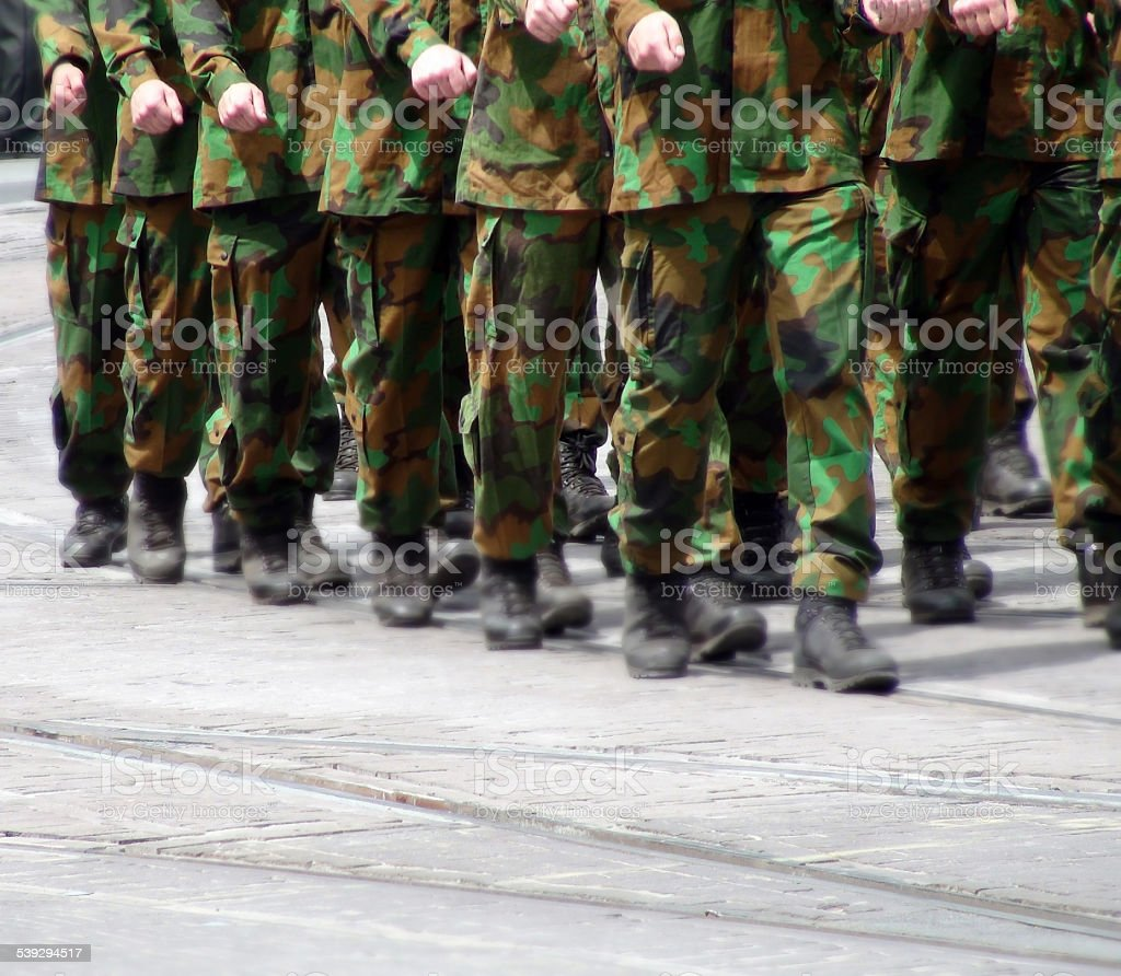 Soldiers marching stock photo