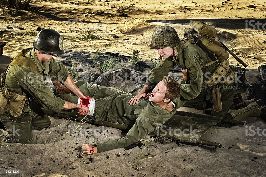 WWII Soldiers - Medic Wounded And Private Triage stock photo