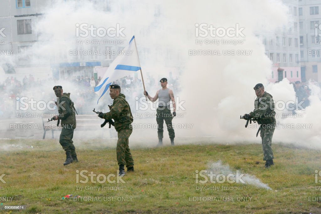 Soldiers of the Russian Marine Corps perform in the town square stock photo