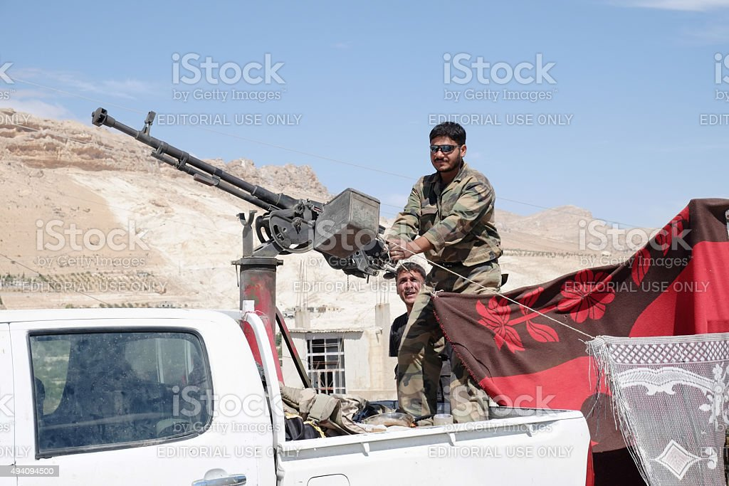 Soldiers of the Syrian National Armynear the heavy machine gun stock photo