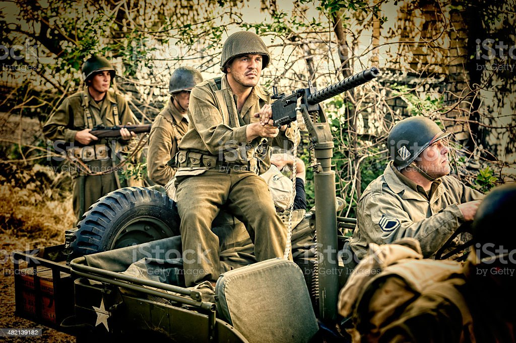 WWII Soldiers on Patrol for the Enemy with Machine Gun stock photo