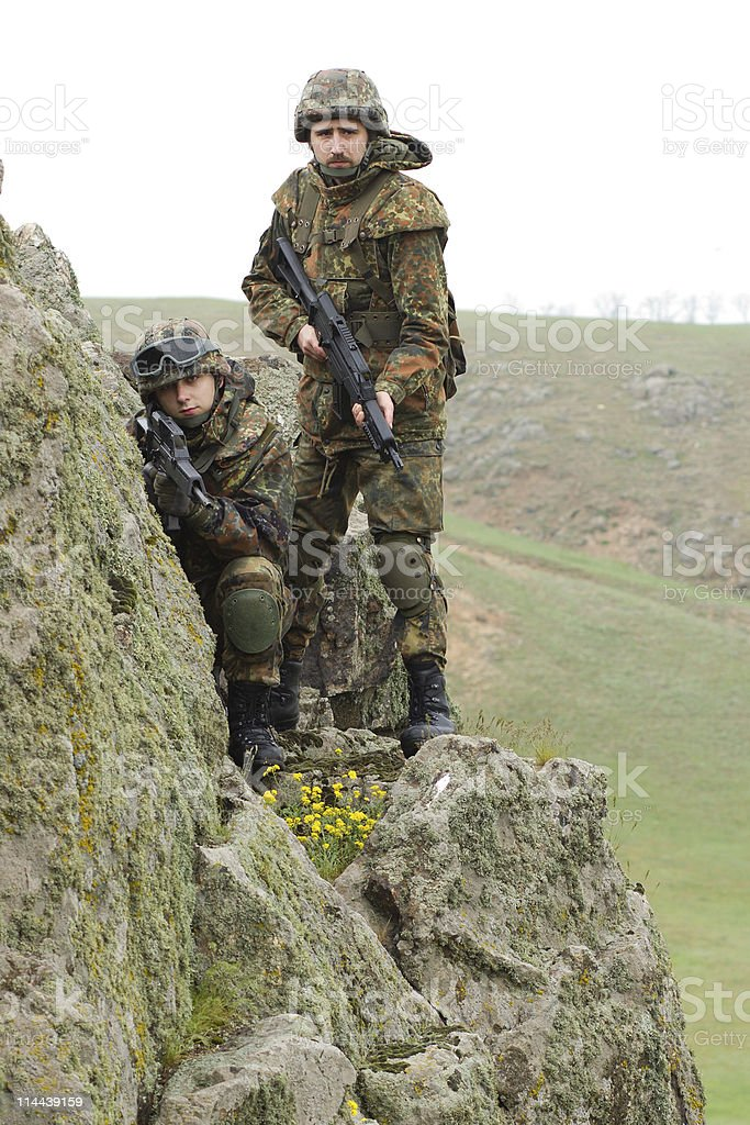 Soldiers on the rock royalty-free stock photo