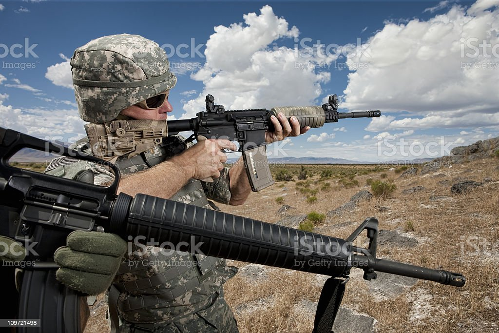 Soldiers Patrolling in Desert royalty-free stock photo