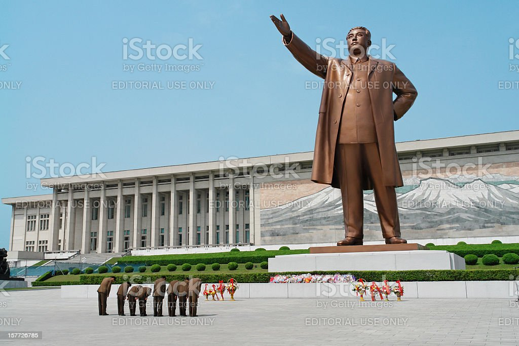 Soldiers paying respect to Kim Il-sung stock photo
