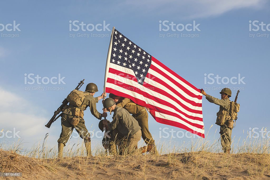Soldiers Raising the US Flag royalty-free stock photo
