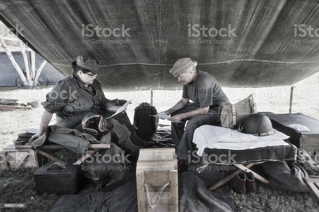 U.S. Soldiers Reading Letters From Home stock photo