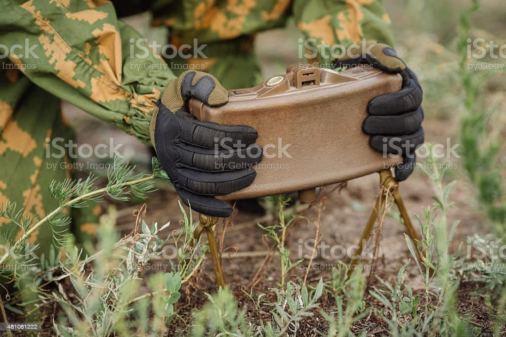 soldiers set mine in the grass stock photo